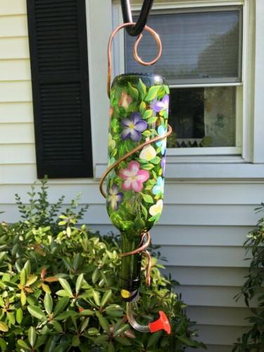 hand painted glass hummingbird feeder with flower